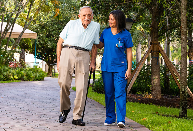 Resident walking with caregiver