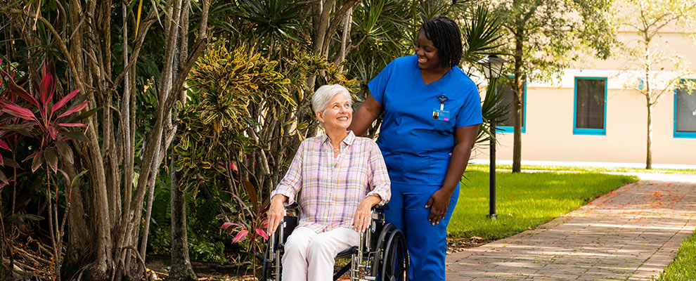 Miami Jewish EmpathiCare elderly woman patient in wheelchair with nurse
