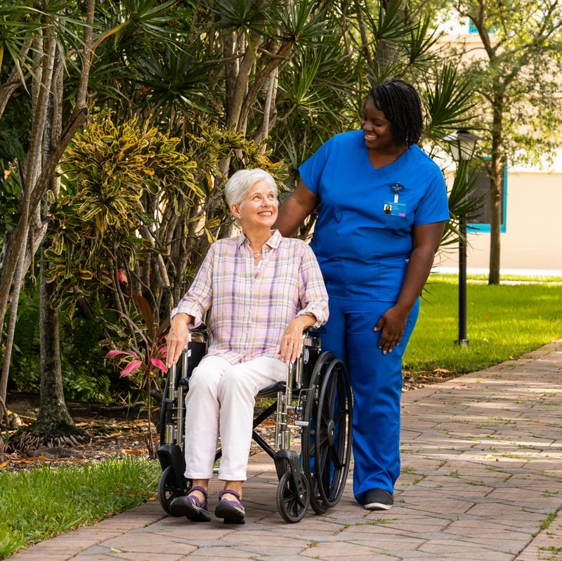 EmpathiCare Nurse and patient in wheel chair