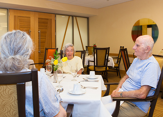 Residents sitting at the meal table at Irving Cypen Tower