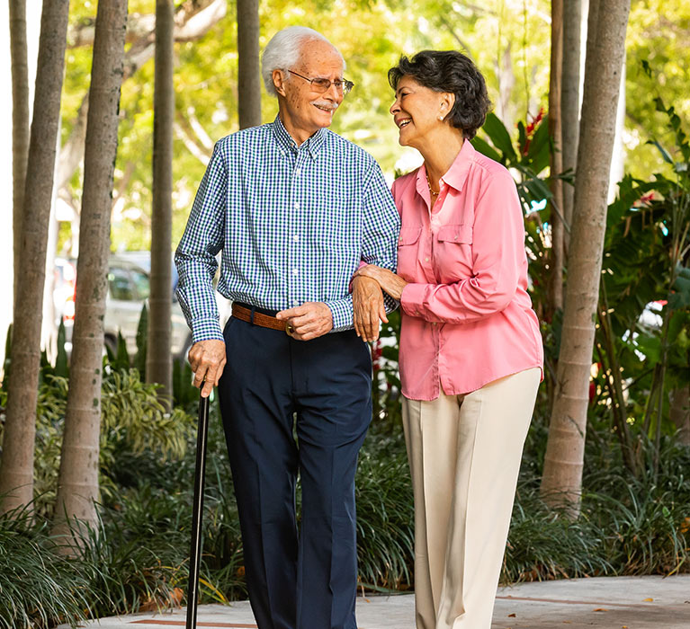 Elderly couple smiling in nature