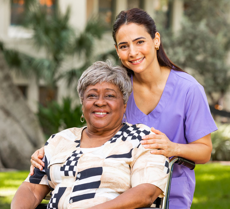 Woman In Wheelchair smiling with Nurse